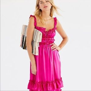 Silk ruffle midi dress with lace up front bodice